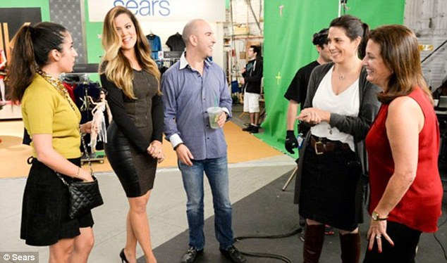 Getting ready: A smiling Khloe chatted happily to the crew backstage