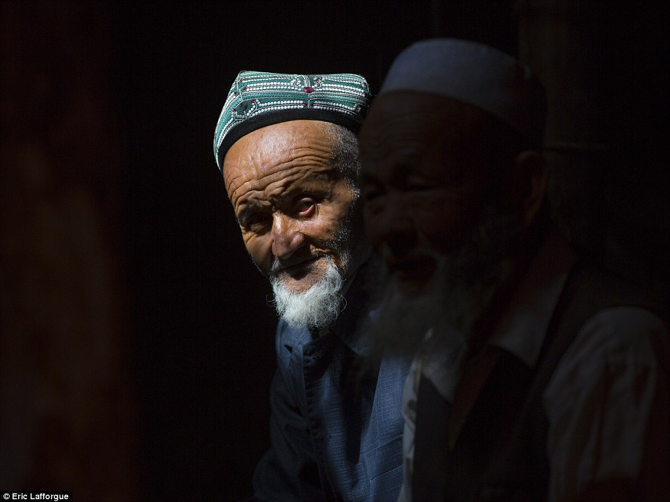 Persecution: Men who grow traditional beards are barred from government roles. More recently Beijing introduced laws that forbid lawyers - and their families - from wearing them