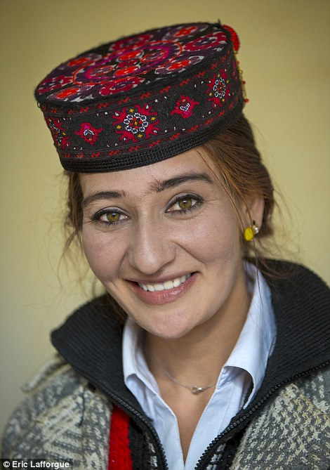 A Uighur woman who has travelled into China from neighbouring Tajikistan