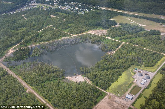 Expanding: The Bayou Corne sinkhole covers 24 acres and has been sucking in trees and swamp