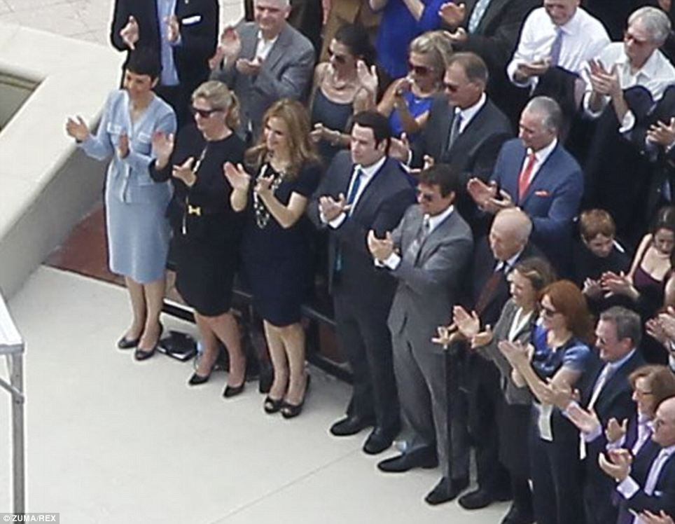 In the front row: Tom Cruise and John Travolta side-by-side in the front row as the Church of Scientology's Flag Building in downtown Clearwater, Florida is opened. The building is rumored to have a floor where members can get 'super powers'