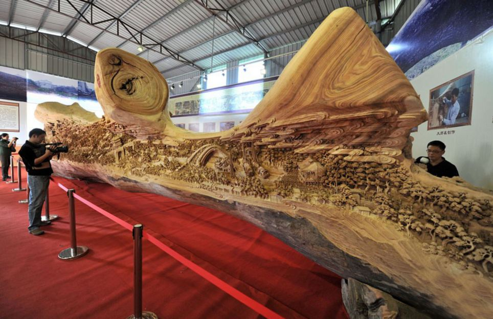 Chinese artist Zheng Chunhui took four years to complete this wood carving which is a copy of a famous painting. It has won the Guinness World Record for the longest wooden carving and measures over 40ft