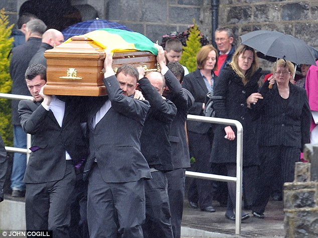 Anguish: Con Towmey's coffin is carried out of St Joseph's Church, in Meelin, Cork, in May. He never recovered from a brain injury sustained in the collision and died 10 months after the crash in July last year