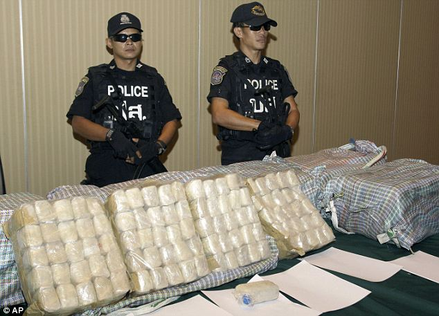 A pan-Asian problem: Authorities say the super meth pipeline runs from North Korea to China and beyond. But Southeast Asia is also seen as a major world producer of the drug. Here, Thai officer stand behind 2 million capsules of meth seized in 2012