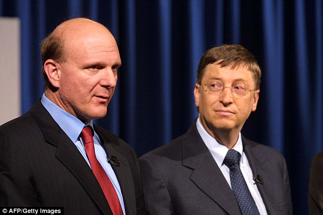 Microsoft CEO Steve Ballmer (L) and Chairman Bill Gates (R) answer questions 01 November 2002 in Redmond, Washington