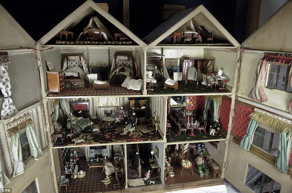 A beautiful Victorian doll's house made by a couple for their six-year-old daughter more than 150 years ago is set to be auctioned