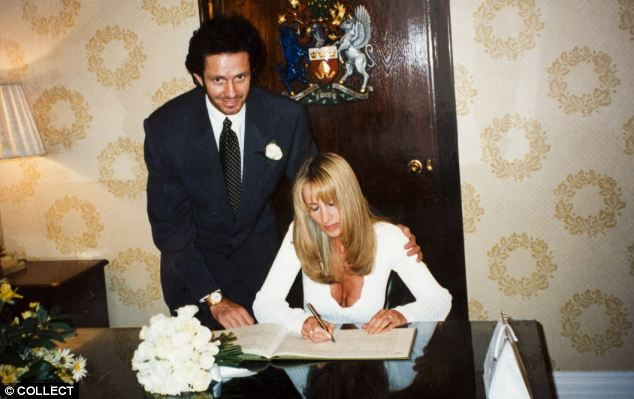 Happier times: Bitter divorcees Scot and Michelle Young pictured on their wedding day in 1995