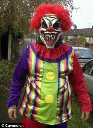 A picture of a man dressed in a sinister clown costume taken from a Facebook page called 'Spot the Burnley Clown' which has sparked panic after social media users falsely claimed he was terrorising the area