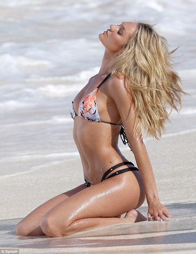 Romancing the sand: Candice seemed to be perfectly happy with her job environment
