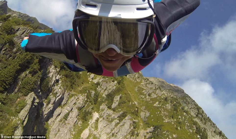 Miss Brennan captures herself mid-flight as she wingsuit flies over mountains in Chamonix, France