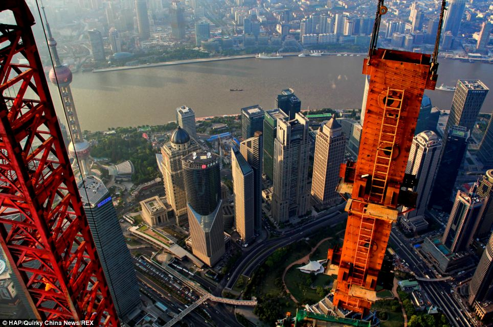 A hobby photographer took these award-winning photographs looking out over Shanghai from the crane he operated