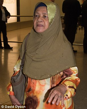 Flying in: Malaysian Kamar Mautum, a retired teacher, arrives at Heathrow from Kuala Lumpur