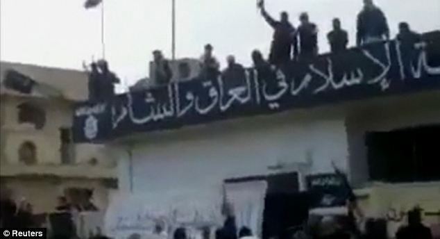 The anti-Assad Syrian Observatory for Human Rights monitoring group posted the video, that shows this ISIL banner