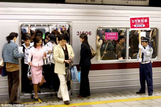 Busy: Commuters at rush-hour on the subway in Tokyo, Japan (pictured)