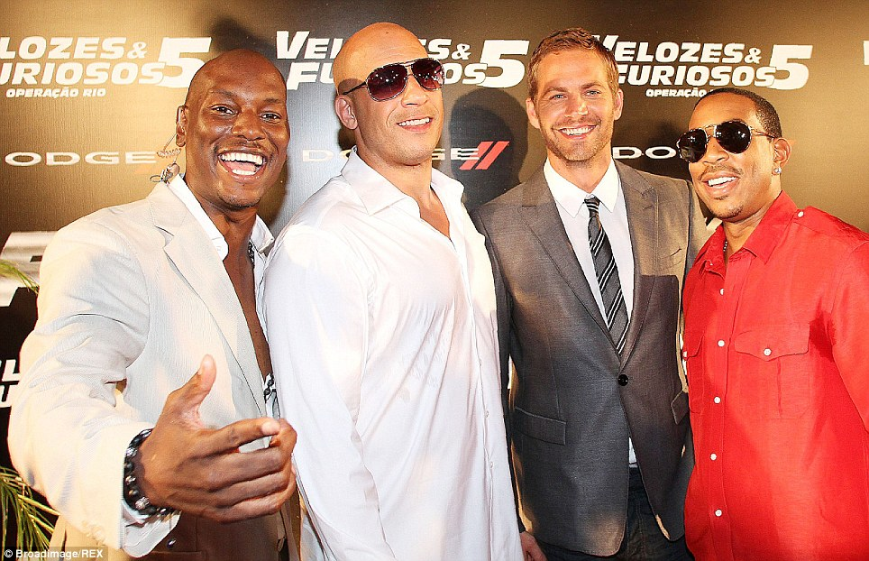 Castmates: Paul Walker with Tyrese Gibson (left), Vin Diesel (center left), and Ludacris (right) at the premiere of Fast & Furious 5 in Brazil, 2011