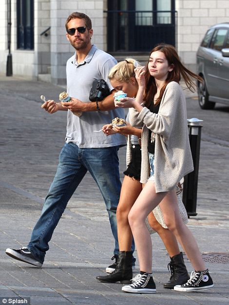 Father daughter day: Here, Walker is pictured with his 15-year-old daughter Meadow (far right) as he takes a break from filming in Montreal back in June