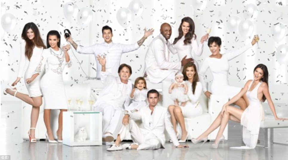 What a difference a year makes: The family's holiday card for 2012 was a lot more low-key, and showed all of the clan celebrating while dressed in white