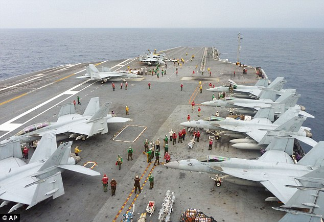 Tensions: U.S. Navy FA-18 Hornets cram the flight deck of the USS George Washington during a joint military exercise with Japan in the Pacific Ocean as the territorial row over the disputed islands intensified