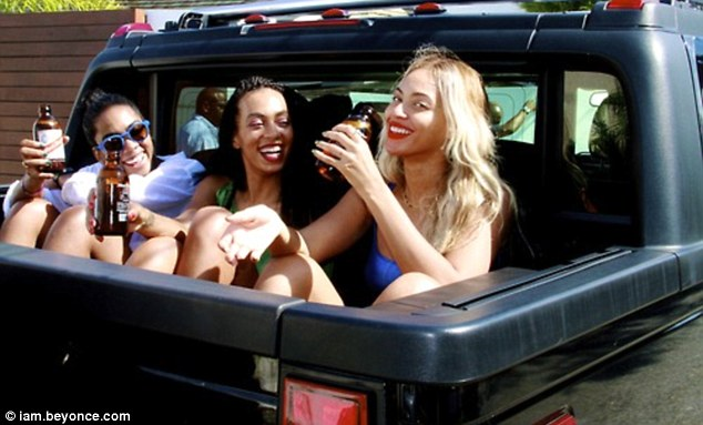 Cheers to that! Beyoncé, Solange and their girlfriend were seen enjoying a refreshment in the back of their SUV
