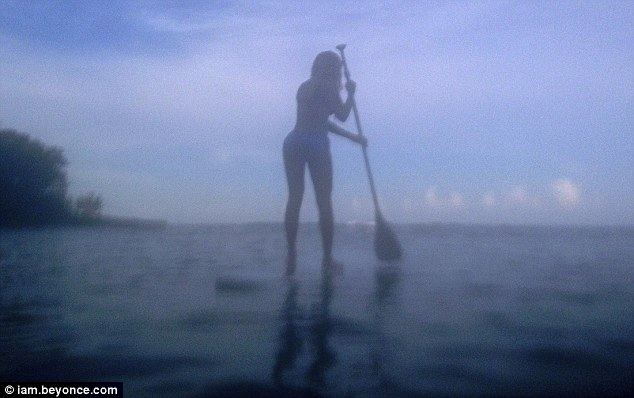 Paddling along: Beyoncé also shared a shot of herself paddleboarding on the break