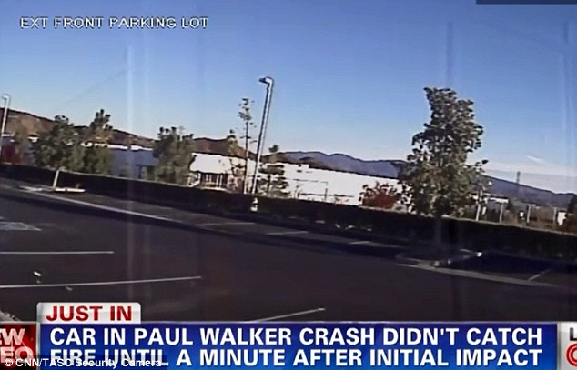 Moment of impact: In the center of the image taken from a security camera opposite the crash scene where Paul Walker died a tree to the left of a light pole can be seen to waver - as Walker's Porsche Carerra GT hits