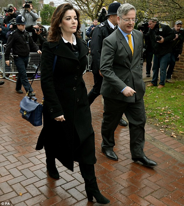 Arrival: Nigella Lawson walks into Isleworth Crown Court this morning where she will face questions about allegations of drug use