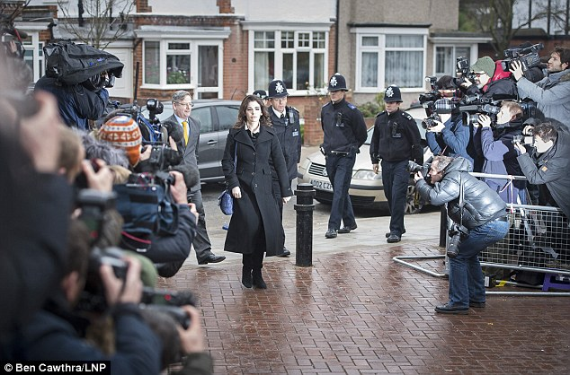 World's media: Nigella Lawson arrives at court followed by seven policeman with dozens of camera lenses trained on her