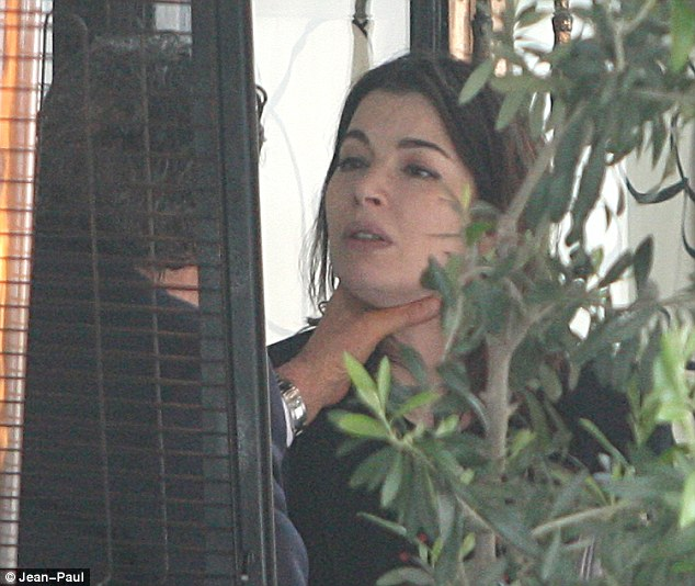 'Choking': Nigella Lawson separated from Charles Saatchi after this picture was published which appeared to show him choking her outside Scott's restaurant in Mayfair, central London