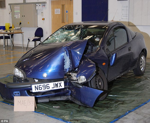 Shocking: This is the first photo of the Vauxhall Tigra that was used during the killing of Fusilier Lee Rigby which was shown in court during the trial of Michael Adebolajo, 28, and Michael Adebowale, 22, today