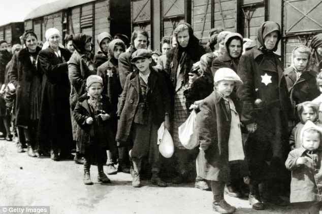 Marched: Hungarian Jews, marked with a Star of David, queue on their way into Auschwitz in 1944, the same time Ivor was taken to the camps (file picture)