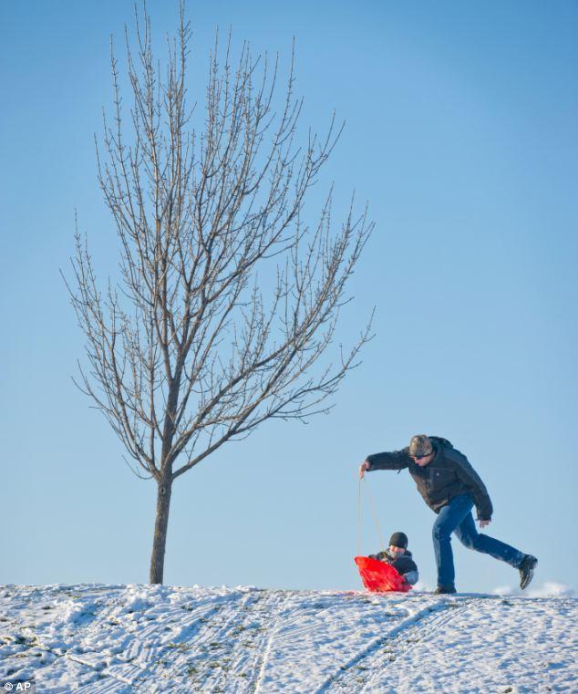 Having fun: Nick Morgan gives his son Parker, 6, a push down a short hill in Walla Walla, Washington