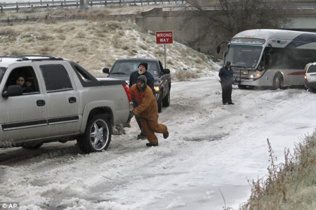 Stuck: Residents work together to clear the roads on East Lancaster Avenue in Fort Worth, Texas