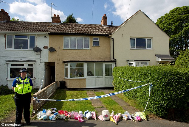 Tragedy: Floral tributes placed outside the home of Yvonne Walsh in Chells Grove, Billesley, Birmingham, after she was found dead with her baby son