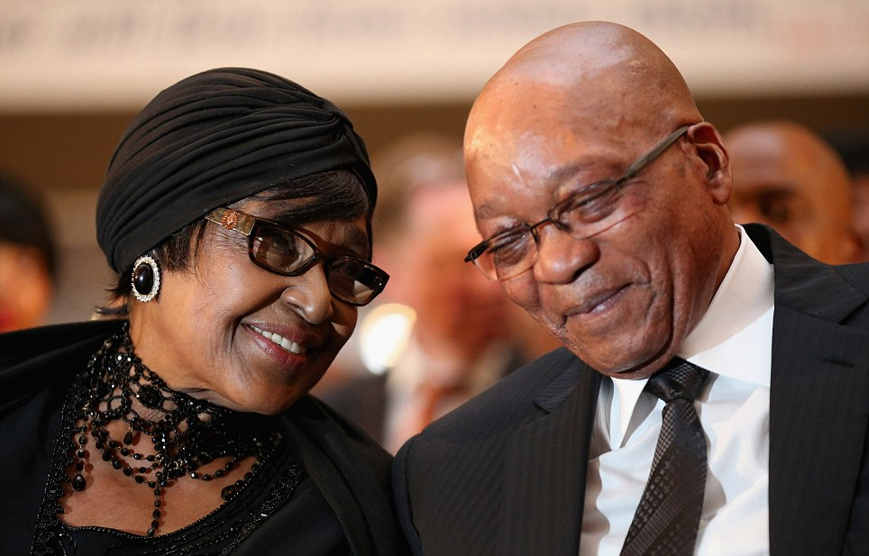 Winnie Madikizela-Mandela and President Zuma smile and laugh as the watch children being baptised during the service at Bryanston Methodist Church