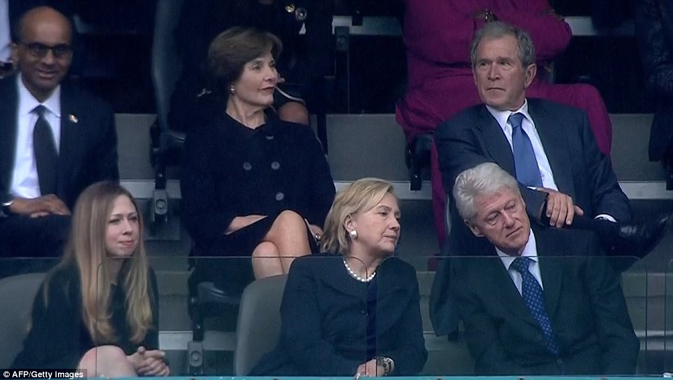 Rivals: But George W. Bush, pictured with wife Laura, apparently got on well with his successor Bill Clinton, pictured with wife Hillary and Chelsea