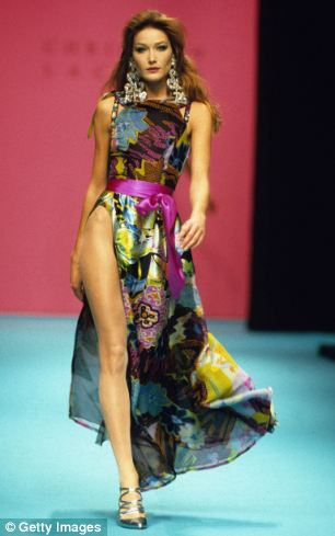 Model Carla Bruni walks the catwalk at a Christian Lacroix High fashion show (circa 1995) in Paris, France.