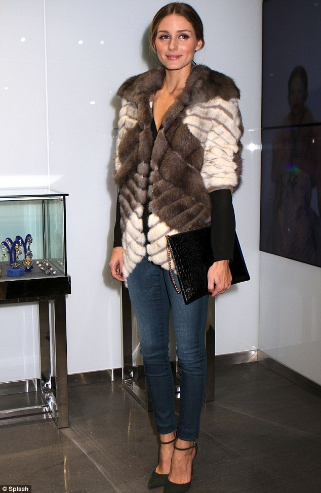 Casually chic: Aside from the warm jacket, Olivia was casually chic in jeans, long-sleeved top and green heels