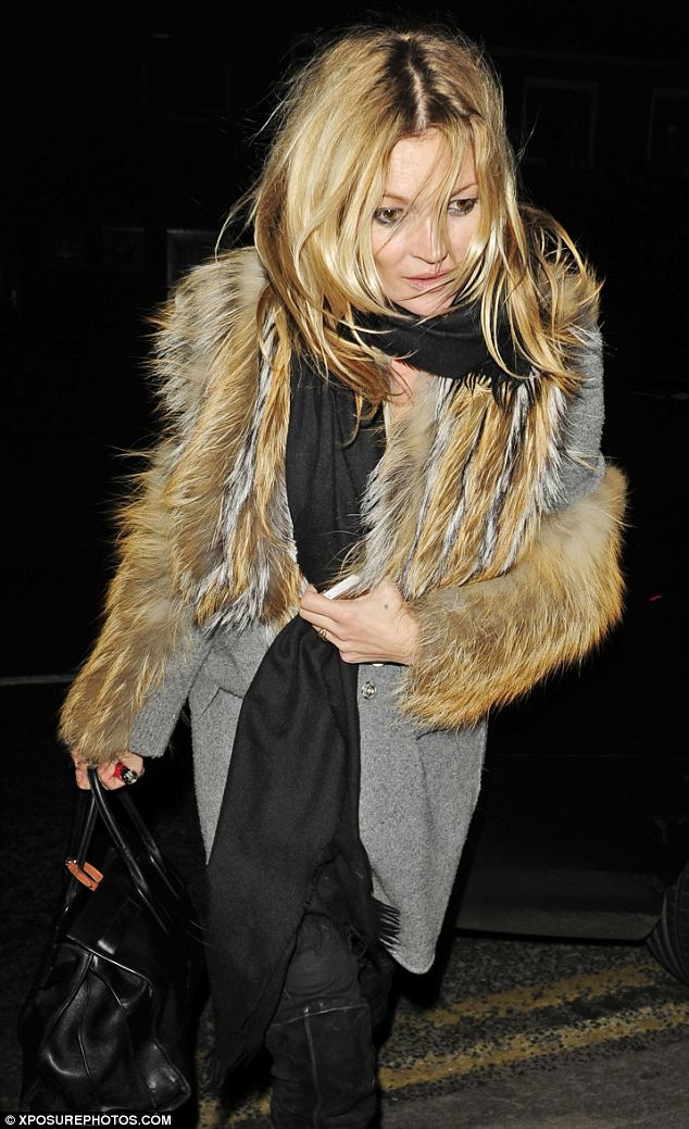 Kate Moss Layers A Fur Stole Over A Black Scarf And Grey