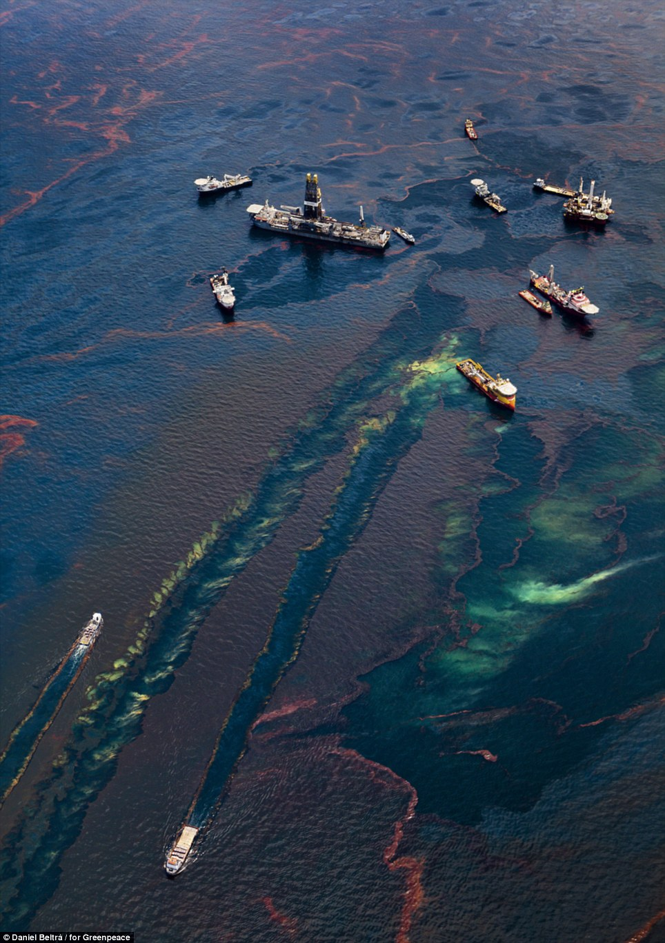 Boats gather near remaining oil platforms near the site of the Deepwater Horizon wellhead, leaving oily wakes as they move through the polluted water. Nearly one third of all U.S. oil production comes from 3,500 such platforms in the Gulf of Mexico