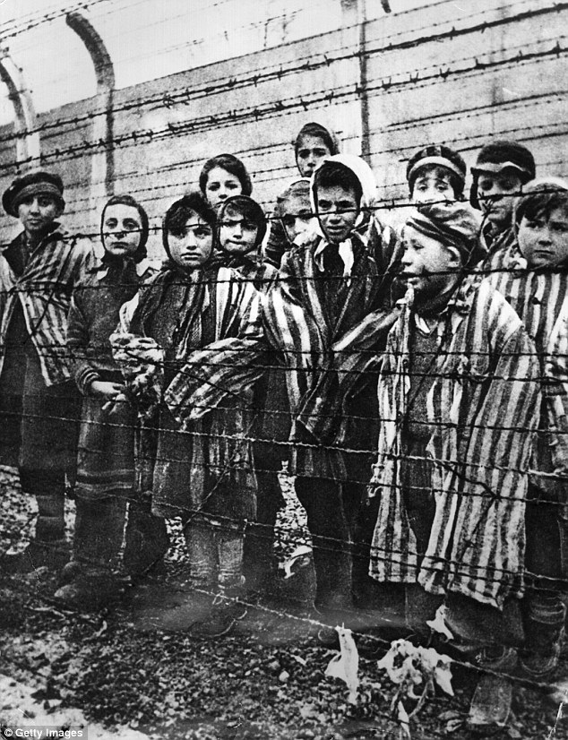 Work: Children are seen behind barbed wire in Auschwitz