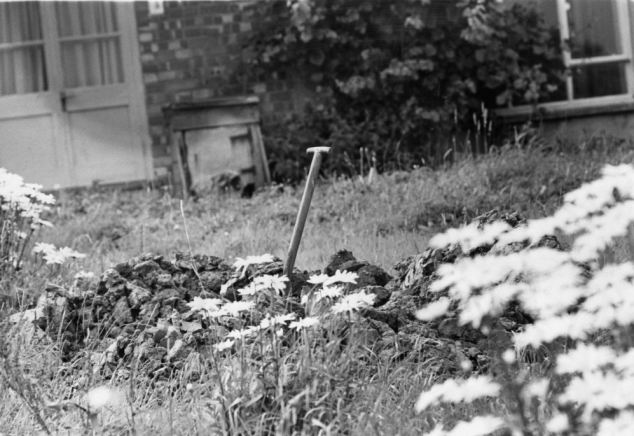 A spade in a hole dug at Leatherslade Farm by the train robbers to burn the mailbags