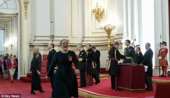 Giggles: Adele appeared to have a severe case of the giggles as she walked away after meeting Prince Charles