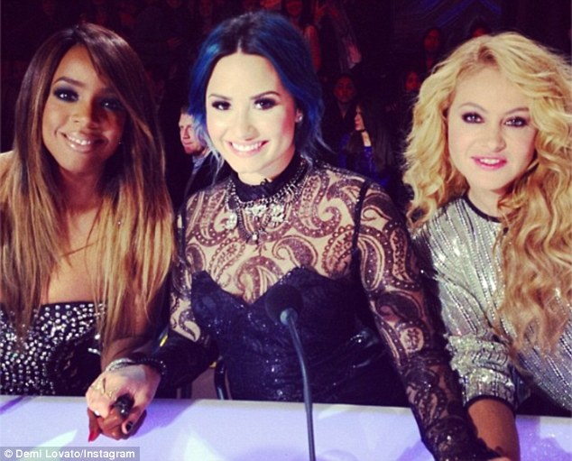Ladies night: The X Factor judges Kelly Rowland, Demi Lovato and Paulina Rubio hold hands during the season finale