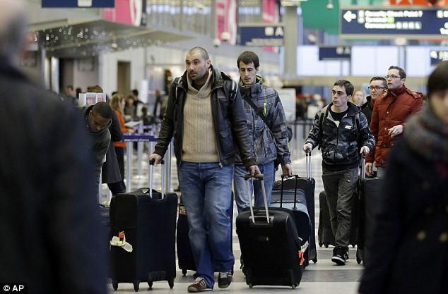 Delays possible: Passengers walk inside Terminal 3 at O'Hare International Airport in Chicago on Friday. A selection of foul weather is arriving just in time for one of the busiest travel weekends of the year
