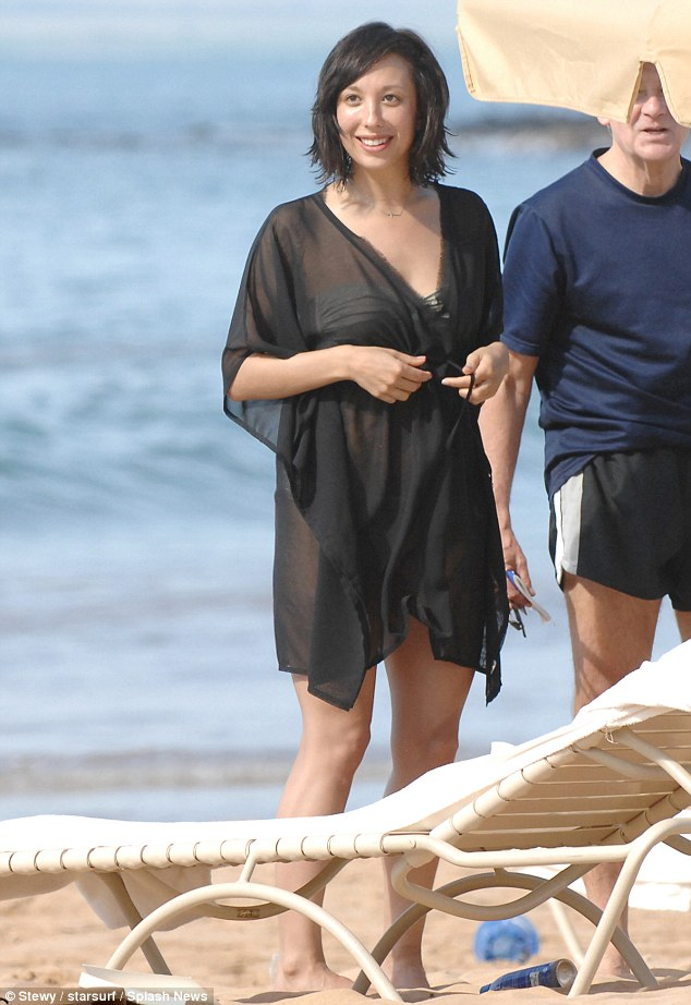 Flattering: The short black kaftan was the perfect cover-up for the star's two piece