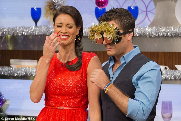 Brave face: Melanie has been keeping upbeat as a presenter on Let's Do Christmas Lunch with Gino and Mel