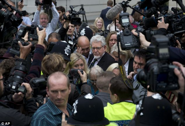 Court date: Harris leaves Westminster Magistrates' Court in September, after he was charged with the initial allegations