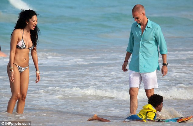 What a pro: Kenzo took to the water as his mother and her boyfriend looked on