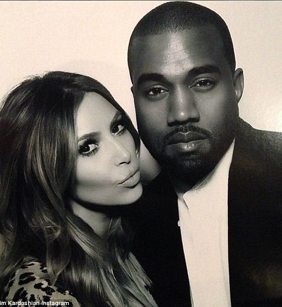 Cool cats: Kim and Kanye shared this snap from the Christmas Eve party