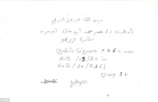 In the name of Allah: This document retrieved from a building occupied by al-Qaida's North African branch in Timbuktu, Mali, is a signed advance to the terror group's fighters. It says: 'In the name of Allah, the most Clement, I gave Omar Mohamed Abou Khalid, the emir of Tashara Zarho, 460,000 fcfa ($920) for his monthly expenses from September 21, 2012 to October 21, 2012 for 34 soldiers.' The document is signed by the fighter